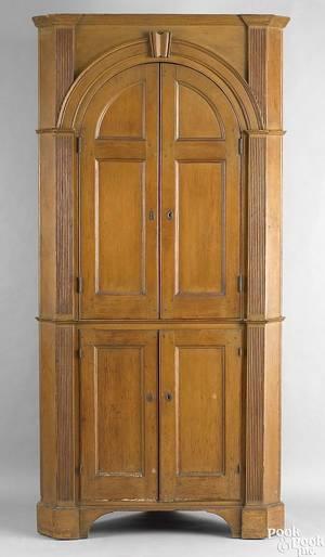 Pennsylvania onepiece pine architectural corner cupboard ca 1800