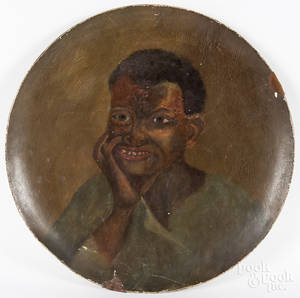 Large painted ppirmache charger with a portrait of an African American boy