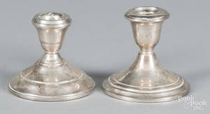 Two pairs of sterling silver weighted candlesticks
