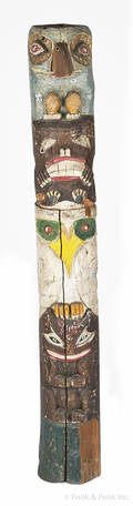 Carved and painted totem pole