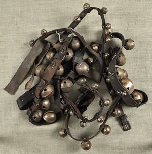 Three strands of brass sleigh bells