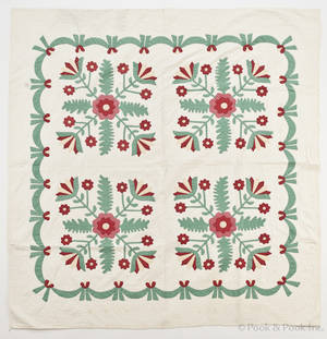 Appliqu whig rose variant quilt with a swag border