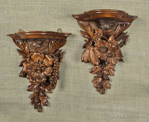 Pair of Black Forest style carved shelves