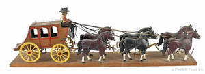 Carved and painted horse drawn stage coach