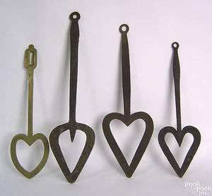 Three wrought iron heart shaped spatulas 19th c