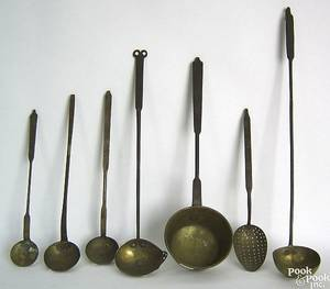 Six wrought iron and brass ladles and skimmer early 19th c