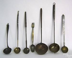 Six wrought iron and brass ladles 19th c