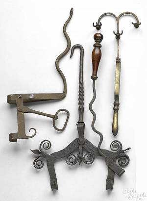 Group of wrought iron fireplace implements 19th c