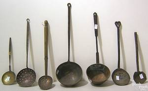 Seven wrought iron brass and copper ladles and skimmers early 19th c