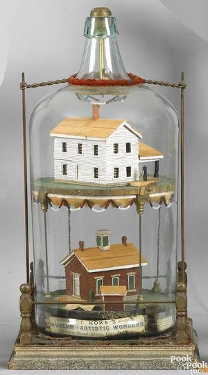 Carved and painted school and house in a bottle