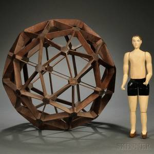 Mahogany Geodesic Sphere and a Carved and Painted Wooden Articulated Figure of a Man
