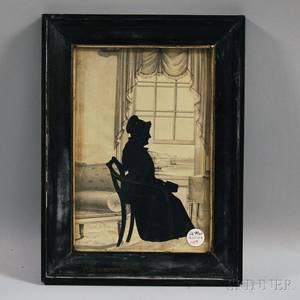 Framed Silhouette Portrait of a Woman at a Window