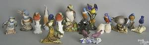 Large group of pottery and porcelain bird figurines
