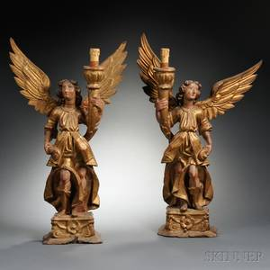 Pair of Spanish Colonial Carved Painted and Gilded Wood Angelform Candlesticks