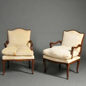 Pair of Louis XVstyle Walnut Fauteuils
