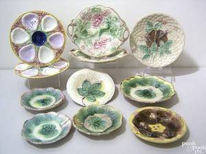 Eleven pieces of majolica to include a pair of geranium cake trays with twig handles