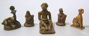 Southern redware figure of a seated man 19th c