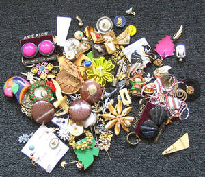 Group of costume jewelry to include pins
