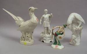 Three Continental White Glazed Ceramic Figures and a German Porcelain Figure of a Persian Man with a Sword