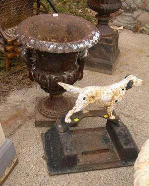 Black Painted Campagnaform Cast Iron Garden Urn and a Painted Cast Iron Hunting Dog Book Scraper