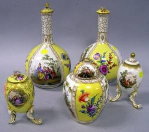 Pair of German Handpainted Bottleform Porcelain Vases a Covered Jar and Two Small Covered Footed Eggform Jars