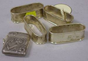 Set of Four Tiffany  Co Sterling Silver Napkin Rings and an Art Nouveau Silver Match Safe