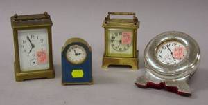 Tiffany  Co Brass and Glass Carriage Clock a Sterling Silver Table Clock a German Enamel and Brass Table Clock and a Small Brass T