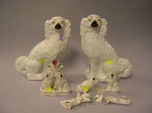Pair of Staffordshire Spaniels and a Pair of Staffordshire Figural Dog Groups