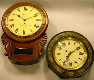 English Inlaid Mahogany Wall Clock and a French Ebonized and Faux Painted Wall Clock