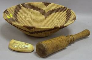 Scrimshaw Decorated Whales Tooth a Tiger Maple Pestle and a Native American Coiled Basket