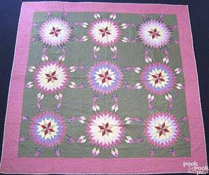 Mennonite pieced quilt with 9 stars within a pink and green borders