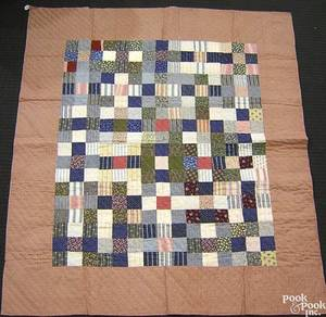 Mennonite pieced quilt in a block pattern