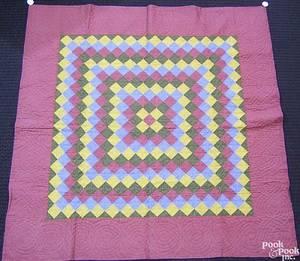 Mennonite pieced quilt in a block pattern