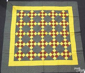 Mennonite pieced quilt in a block pattern with red
