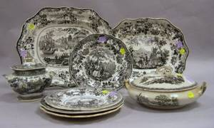 Four Assorted English Black and White Transfer Decorated Staffordshire Plates Two Platters a Covered Serving Dish and Sugar