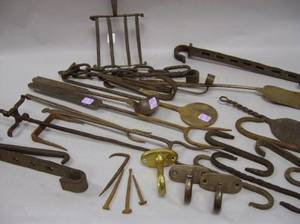 Approximately Twentyfive Wrought Iron and Brass Hearth and Hardware Items