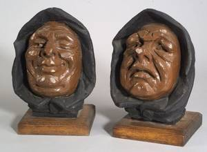 Pair of Late 19th Century Carved and Painted Architectural Wooden Hooded Heads