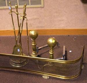 Pair of Brass Balltop Andirons a Pierced Brass Fire Fender and a Brass Stand with Set of Brass Tools