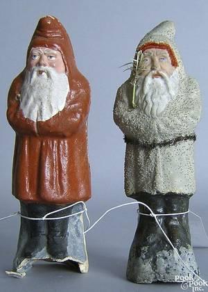 Two paper mache Santa Claus figures