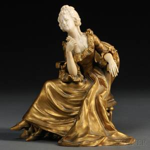 Continental School Early 20th Century Bronze and Ivory Figure of a Seated Woman with a Rose