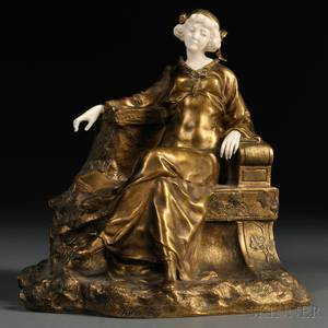 Theophile Francis Somme French 18711952 Bronze and Ivory Figure of a Seated Woman in a Garden