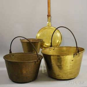 Three Nesting Brass Kettles with Wrought Iron Swing Handles and a Brass Bedwarmer with Turned Wood Handle