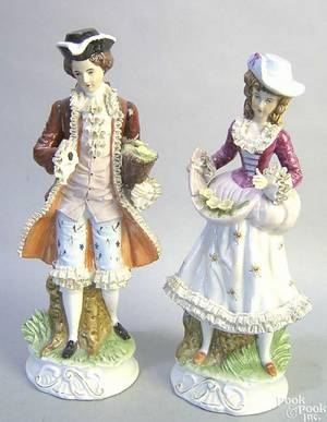 Two Dresden porcelain figures of a man and woman in colonial garb