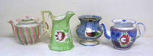 Spatter to include a green pitcher with tulip decoration