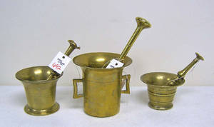 Three brass mortar and pestle