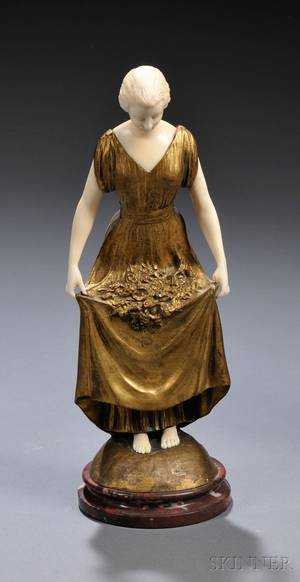 Joe Descomps French 18691950 Giltbronze and Ivory Figure of a Woman with Flowers