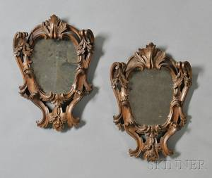 Pair of Italian Baroquestyle Carved Walnut Mirrors