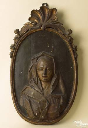 Italian or German relief carved pine oval polychrome and gilt panel of the Virgin early 18th c