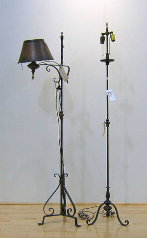 Two wrought iron floor lamps