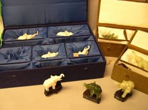 Two Pairs of Cased Chinese Carved Jade Elephant Figures and a Set of Five Chinese Carved White Jade Elephant Figures